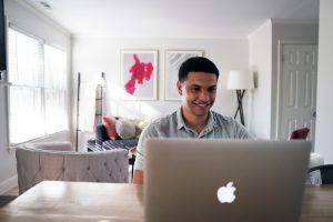 mortgage broker working on laptop